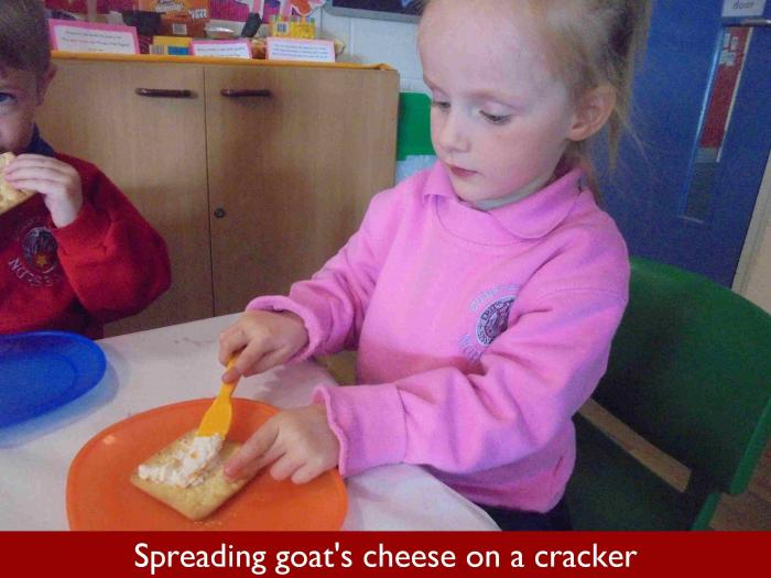 7 Spreading goats cheese on a cracker