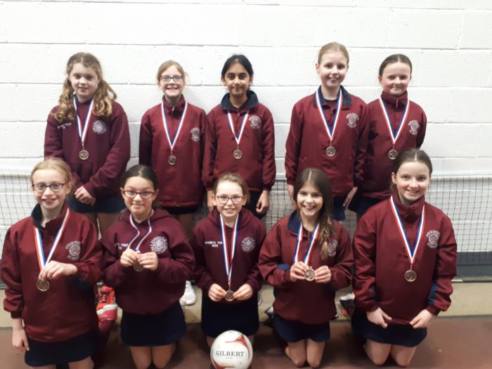 Girls awarded 3rd place and bronze medals