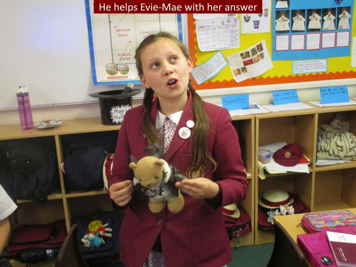 3 He helps Evie Mae with her answer